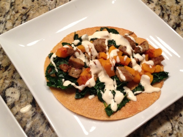 Socca with Veggie Sausage Squash & Kale, topped with Buttermilk Viniagrette
